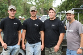First place in this summer's M&R Bow Fishing Tournament went to Triple X Bow Fishing out of Kuttawa, Ky.  Team members include (L to R):  Jim Ed Gill, Ryan McKinney, and John Guess, along with.  Roger Snodgrass (far right) of M&R Bowstrings stands along