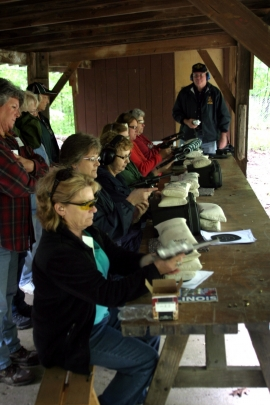 Participants try their hand at target practice during the spring WITO event at Camp Ondessonk in Ozark, Ill.