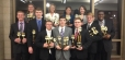 Forensic Falcon State Champions are (Front Row, L-R): Nick Volkening of Galatia, Nick Mott of Simpson, Austin Winters of Carmi, Jeremiah Brown of Harrisburg, Benjamin McGuire of Raleigh, Zachary Hanks of Harrisburg, and Tre Ingram of Harrisburg.  Back Row (L-R): Nicole York of Omaha, Corrine McDaniel of Harrisburg, Hannah Rodgers of Harrisburg, and Bethany Oxford of Norris City.