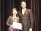 Bethany Oxford of Norris City accepts the Dennis/Allan Speech Scholarship from presenter Tyler Billman.