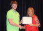 Lucas Weir of Eldorado accepts the Eldorado Women's Club scholarship from presenter Ayn Bartok.