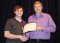 Sean Partain of Harrisburg accepts the George T. Dennis Memorial Scholarship from presenter Allan Kimball.