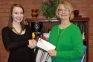 Meredith Wolf of Harrisburg (left) receives a $50 check from Dr. Dana Keating, SIC Vice President for Academic and Student Affairs, for winning the 2015 Paul Simon Essay Contest at Southeastern Illinois College.