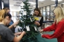 Emily Green of Golconda (center) smiles as she reads the toy requests of one of the children on the SIC Angel Tree.