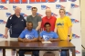 Izayah Thurman of Massac County signed his intent to join the SIC Bowling Falcons. Pictured are (sitting, l-r) father, Russell Thurman and Izayah Thurman. Standing are (l-r) Doug Cottom, SIC Head Coach Doug Cottom, Massac County Head Coach Jason Steele, Massac County Assistant Coach Gary Adkins, and Kerri Dunn.